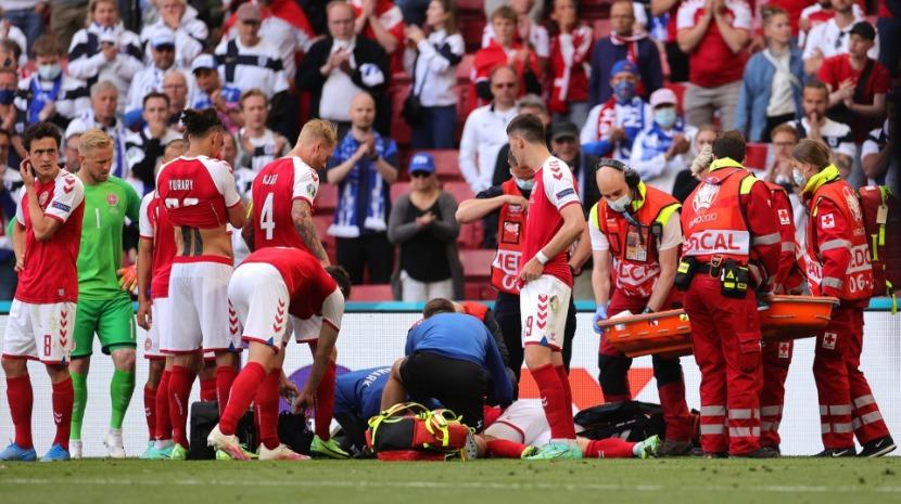 Photo of Christian Eriksen retirado em maca envolto em consternação | JM Madeira